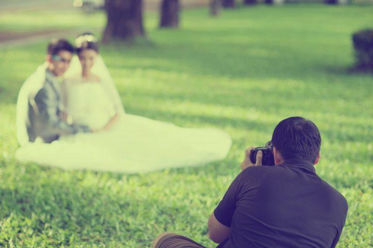 wedding photographer taking photos of the wedding couple