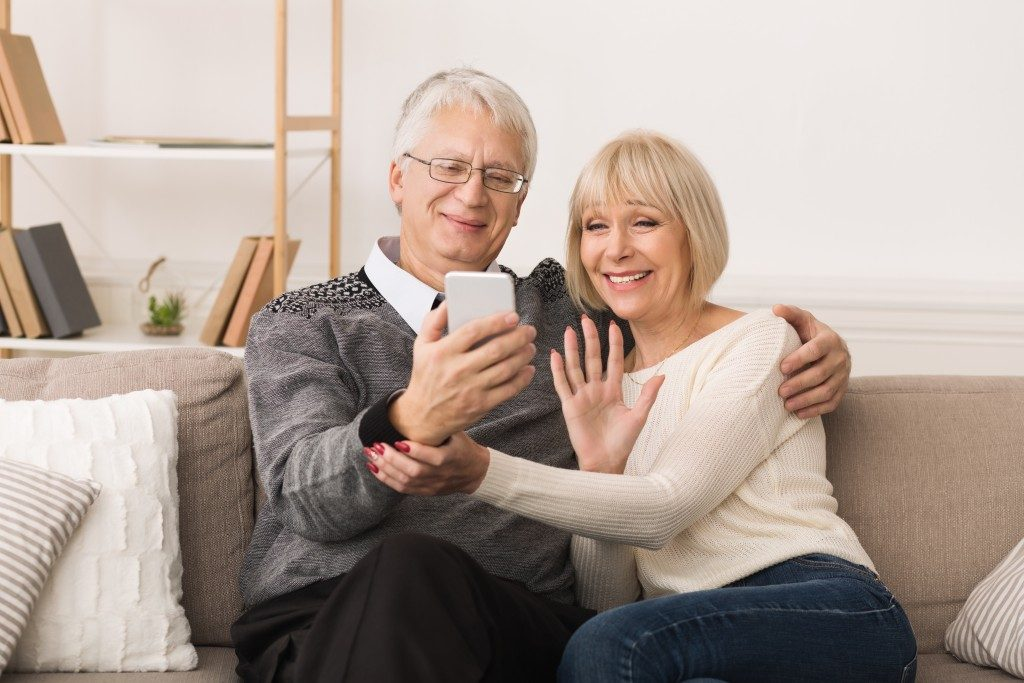 an old couple enjoying a video together